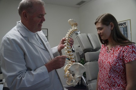 Crowe Chiropractic Doctor Working with Patient